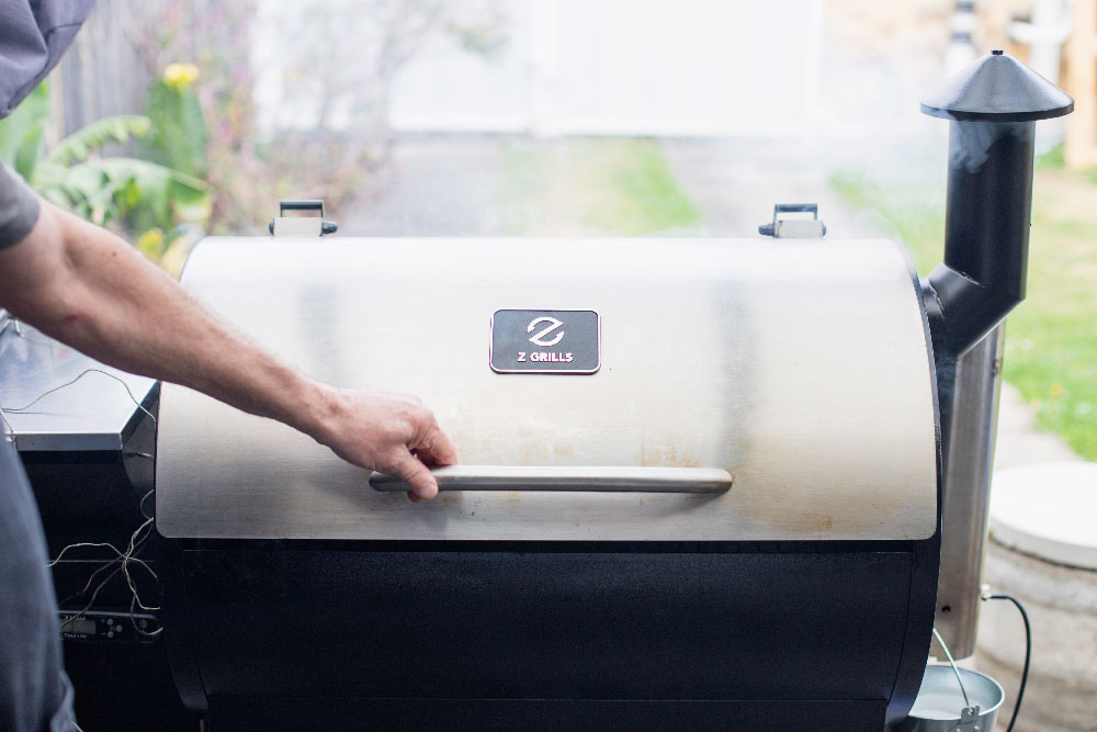 Opening the Z Grills 700E grill lid