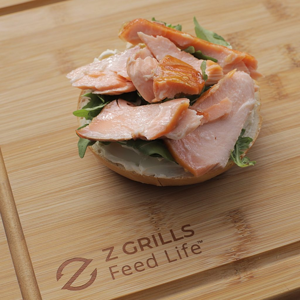 Russ's Smoked Salmon served with cream cheese and rocket on a bagel