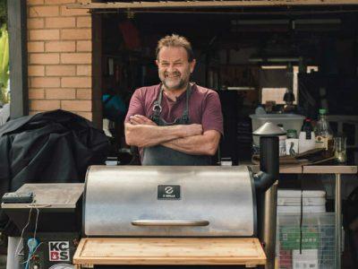 Man behind a Z Grills Pellet Smoker
